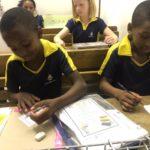 Frank and Owami do homework
